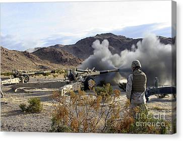 An M198 Howitzer Fires A 155-millimeter Canvas Print by Stocktrek Images