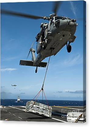An Mh-60s Sea Hawk Helicopter Lowers Canvas Print by Stocktrek Images