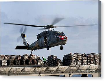 An Mh-60s Sea Hawk Lifts Cargo Canvas Print by Stocktrek Images