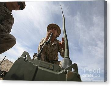 An Officer Conducts A Radio Check Canvas Print by Stocktrek Images
