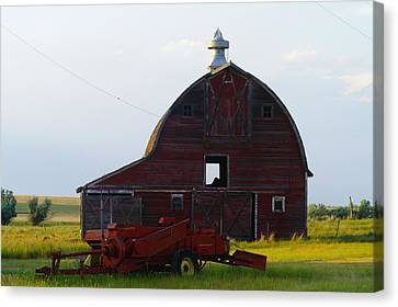 an old barn and bailor in Eastern Montana Canvas Print by Jeff Swan