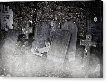 An Old Cemetery With Grave Stones And Fog Canvas Print by Joana Kruse