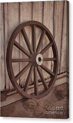 An Old Wagon Wheel Canvas Print by Donna Greene