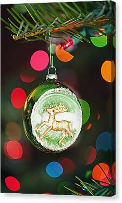 An Ornament With A Reindeer Hanging Canvas Print by Craig Tuttle