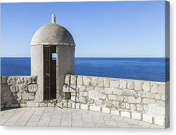 An Outpost Overlooking The Adriatic Sea Canvas Print by Greg Stechishin