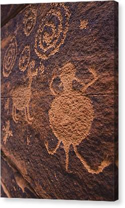Ancient Anasazi Rock Art On Red Canvas Print by Ralph Lee Hopkins