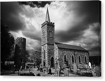 Ancient Glenshesk Armoy Round Tower In The Grounds Of St Patricks Parish Church Armoy County Antrim Canvas Print by Joe Fox