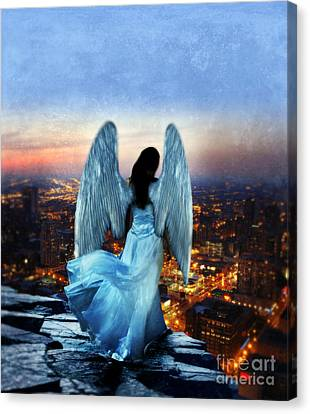 Angel On Rocky Ledge Above City At Night Canvas Print by Jill Battaglia