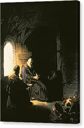 Anna And The Blind Tobit Canvas Print by Rembrandt Harmensz van Rijn
