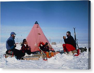 Antarctic Research Team Relaxing Outside Tent Canvas Print by David Vaughan