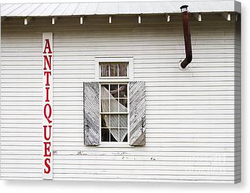 Antique Store Facade Canvas Print by Jeremy Woodhouse