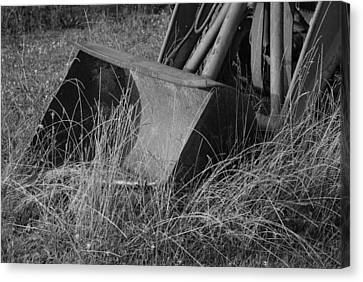 Antique Tractor Bucket In Black And White Canvas Print by Jennifer Ancker