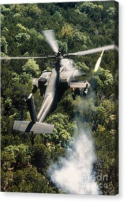 Apache Helicopter Firing Canvas Print by Stocktrek Images