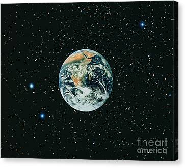 Apollo 17 View Of Earth With Starfield Canvas Print by NASA / Science Source