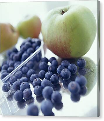Apples And Blueberries Canvas Print by David Munns