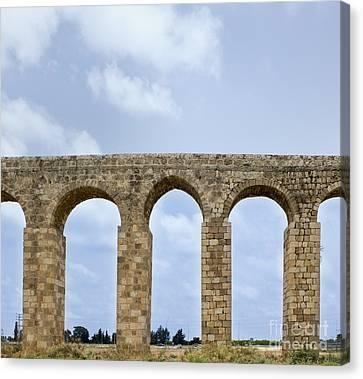 Aqueduct Of Acre Canvas Print by Noam Armonn