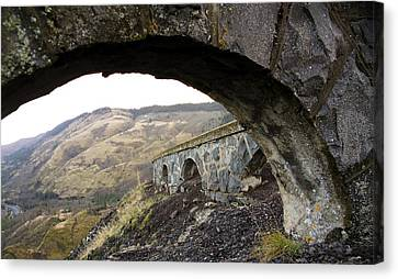 Canvas Print featuring the photograph Arches And Mountains by Steve McKinzie