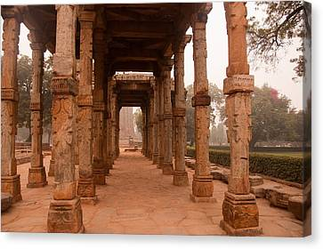 Artistic Pillars Are All That Remain Of This Old Monument Inside The Qutub Minar Complex Canvas Print by Ashish Agarwal