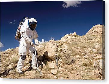 Astronaut Stands Beside A Core Sampling Canvas Print by Stocktrek Images