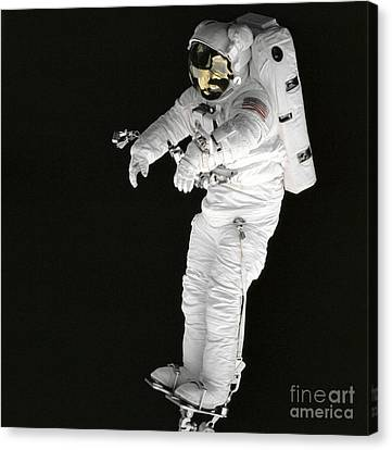 Astronaut Stands On A Portable Foot Canvas Print by Stocktrek Images