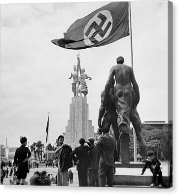 At The 1937 Paris International Canvas Print by Everett