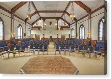 Auditorium With Blue Chairs And A Stage Canvas Print by Douglas Orton