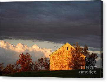 Canvas Print featuring the photograph Autumn Glow With Storm Clouds by Karen Lee Ensley