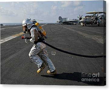 Aviation Boatswain's Mate Carries Canvas Print by Stocktrek Images
