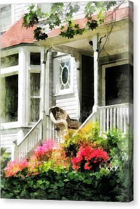 Azaleas By Porch With Wicker Chair Canvas Print by Susan Savad