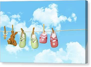 Baby Shoesr And Teddy Bear On Clothline Canvas Print by Sandra Cunningham
