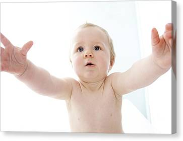 Baby With Arms Outstretched Canvas Print by Ruth Jenkinson