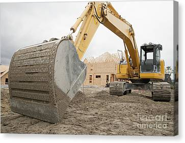 Backhoe On Construction Site Canvas Print by Shannon Fagan