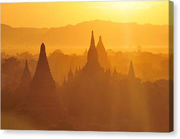 Bagan Stupas In Sunset Light Canvas Print by Huang Xin