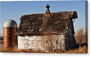 Barn And Silo Canvas Print by Edward Peterson