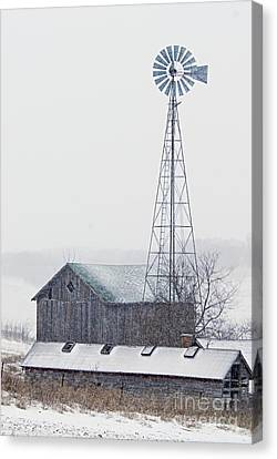 Barn And Windmill In Snow Canvas Print by Larry Ricker
