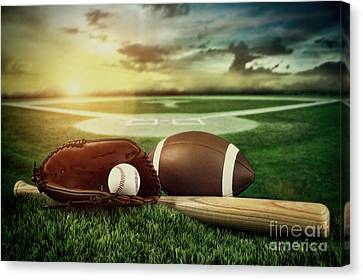 Baseball  Bat  And Mitt In Field At Sunset Canvas Print by Sandra Cunningham