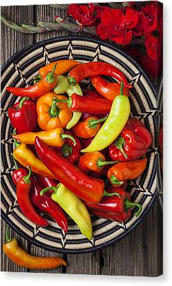 Basketful Of Peppers Canvas Print by Garry Gay