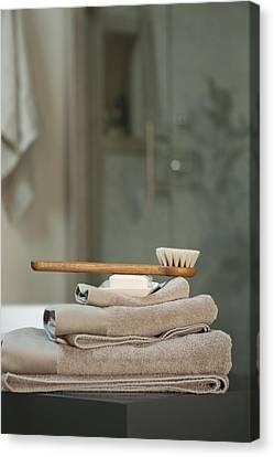 Domestic Bathroom Canvas Print - Bath Brush On Stacked Towels by Karyn R. Millet