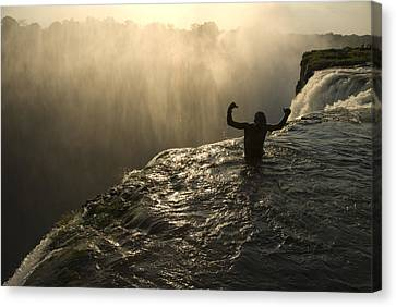Bathing In A Swimming Hole At The Top Canvas Print by Annie Griffiths