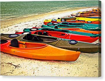 Canvas Print featuring the photograph Beach Kayaks by Susan Leggett