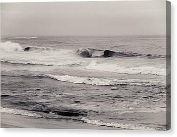 Beach On A Rainy Day Canvas Print by Ezequiel Rodriguez Baudo