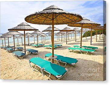 Empty Chairs Canvas Print - Beach Umbrellas On Sandy Seashore by Elena Elisseeva