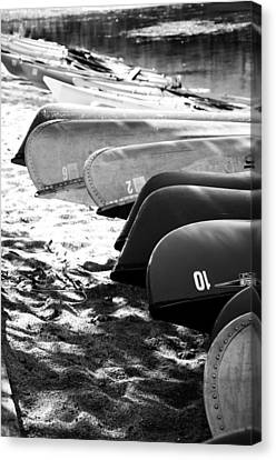 Beached Kayaks Canvas Print by Julia Wilcox