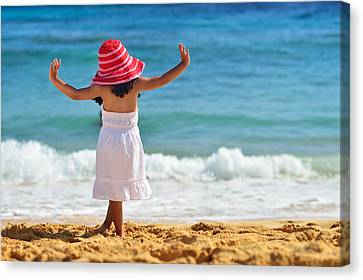 Beautiful Girl With Pink Hat Facing The Ocean Canvas Print by Hegde Photos