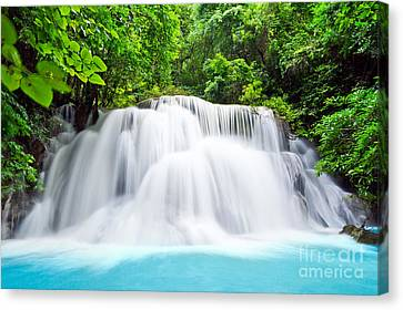 Beautiful Water Fall In The Forest Canvas Print by Mongkol Chakritthakool