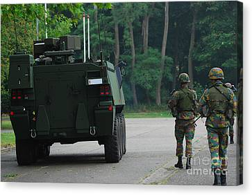 Belgian Infantry Soldiers Walk Canvas Print by Luc De Jaeger