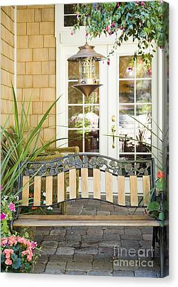 Bench On Patio Canvas Print by Andersen Ross