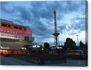 Berlin Fairground Soaked With Red Canvas Print by Manfred Wassmann
