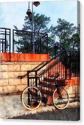 Bicycle By Train Station Canvas Print by Susan Savad