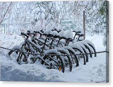 Bicycles In The Snow Canvas Print by Heidi Smith